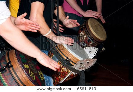 hands playing music on the ethnic drums