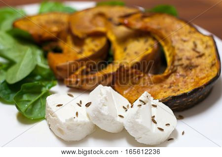 Dish Pumpkin With Spinach, Goat Cheese And Cumin Seeds