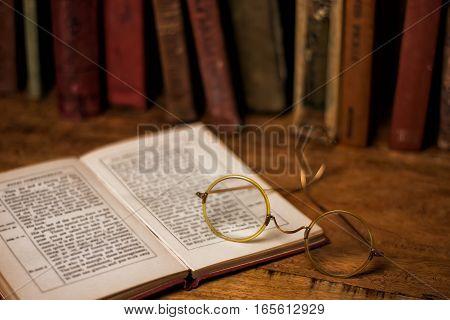 Old Books On The Wooden Bookshelfs, Vintage Eyeglasses