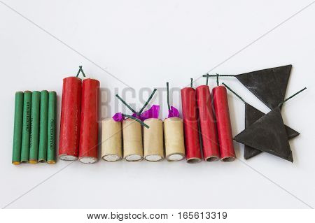 Firecrackers of different types and shapes on a white background