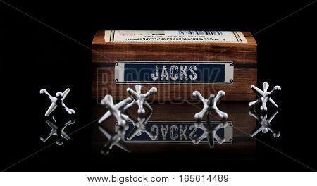 SWINDON UK - JANUARY 9 2017: Game of Jacks on a black background