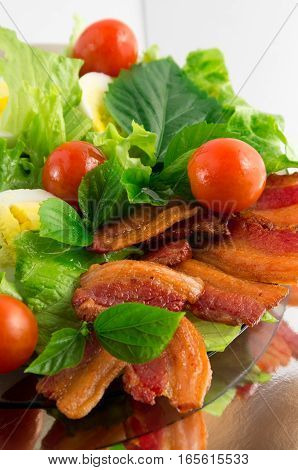 Plate Of Fried Bacon, Cherry Tomatoes And Herbs