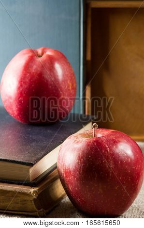 Two Red Apples On An Old Vintage Books