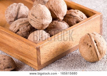 Macro View Of Walnuts Close Up In A Wooden Box