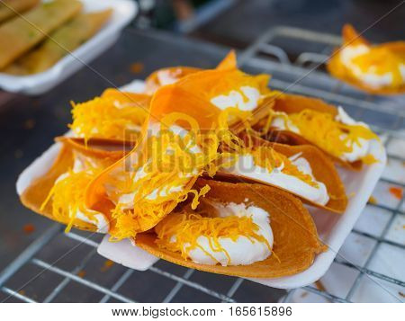 Thai Traditional sweet Snack and Dessert, Thai Crispy Pancake or Thai Crepes Filled with Sweet Coconut Cream and Salted ,street food