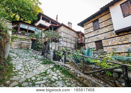 Street and traditional houses at Palaios (old) Panteleimonas village. Pieria Macedonia Greece