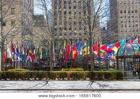 NEW YORK USA - MAY 5 2014: flags of different country near the Rockefeller Center in spring time New York USA