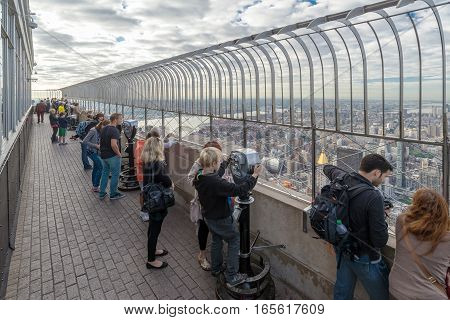 NEW YORK USA - SEPTEMBER 27 2013: people look at Manhattan cityscape from the observation deck