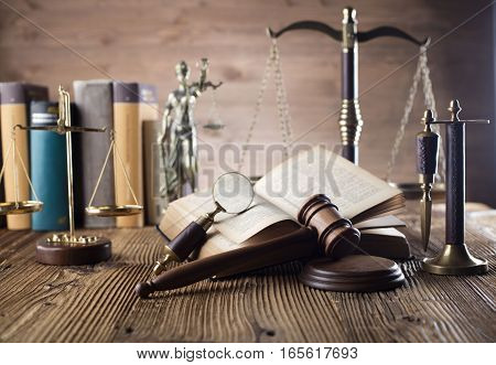 Law theme, gavel of judge, scale of justice and legal code on wooden table