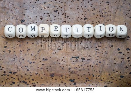 Competition Word On Wooden Cubes On A Brown Cork Background