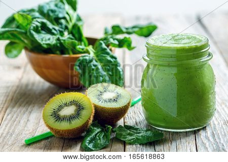 Healthy Green Smoothie In Jar Of Spinach, Kiwi And Celery.