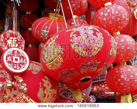 closeup Chinese paper lanterns and decoration ornament for Chinese New Year (Chinese characters mean blessing of health, wealth and good fortune)