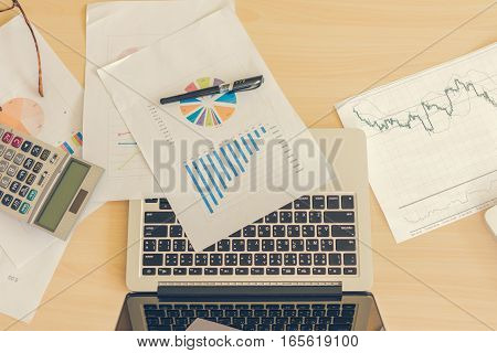 office room with laptop and smart phone business office background with soft focus vintage tone