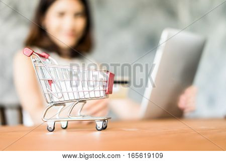 Business beautiful woman shopping online with laptop and credit card sale and business concept soft focus