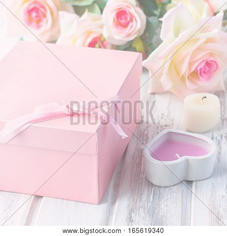 Gift Box, Candle And A Bouquet Of Roses