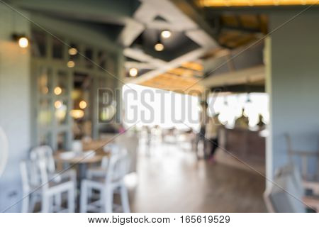 Blur coffee shop or cafe restaurant with bokeh background