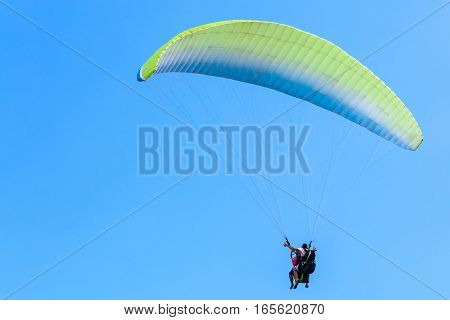 Paragliding In Blue Sky, Instructor And Beginner
