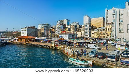 ISTANBUL TURKEY - JANUARY 22 2015: The suppliers bring fish in cars and boats every morning to the central fish market located at the base of Galata Bridge on January 22 in Istanbul.
