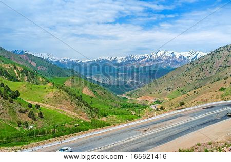 The view from the Kamchik Pass on the snowy peaks of Qurama mountain range Uzbekistan.