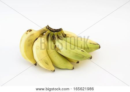 Bunch of Indian yellaki bananas on a white background