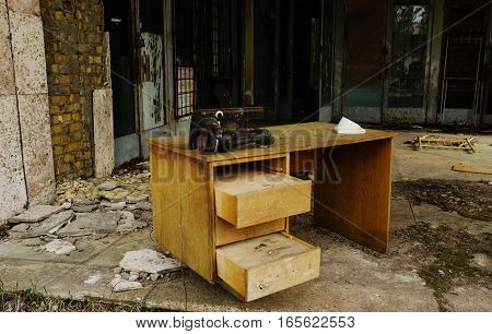 Old Table With Sewing Machine At Chernobyl Ghost Town, Ukraine.