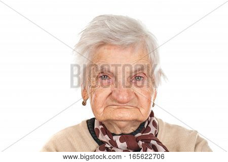 Portrait of an old woman posing on an isolated background