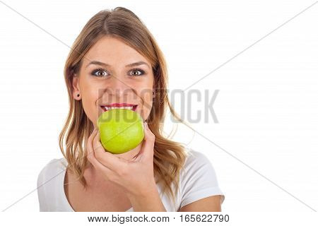 Picture of a beautiful young woman eating an apple