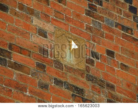 Sundial clock on the vintage bricked wall in Roskilde, Denmark