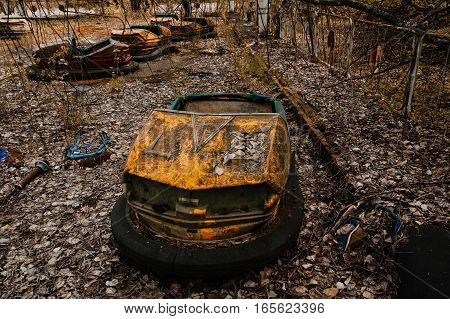 Abandoned Amusement Park With Rusty Cars In Pripyat City At Chernobyl Exclusion Zone.
