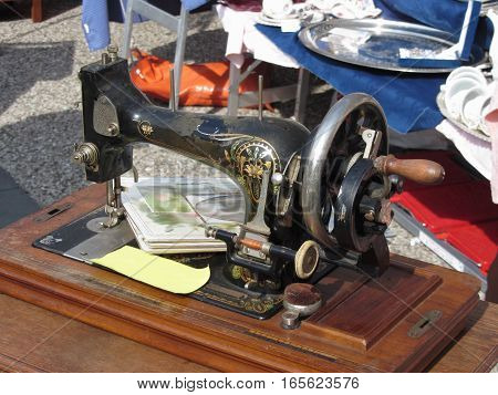 Vintage sewing machine at flea market . Tuscany Italy