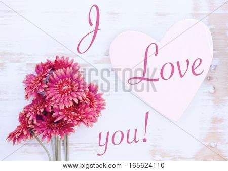 bunch of beautiful red flowers on a white vintage wooden background and the words I Love You