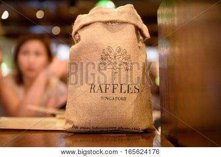 SINGAPORE - OCTOBER 07 2016: Sack of peanuts in the famous Long Bar at Raffles Hotel in Singapore.