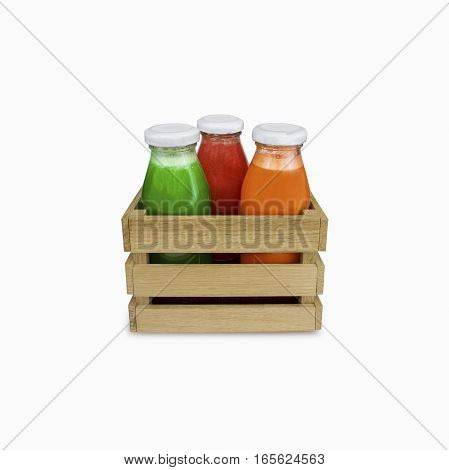 juices bottles in a box (carrot tomato spinach with cucumber). Fresh vegetable juices isolated on white. Healthy eating drinks diet and detox concept.