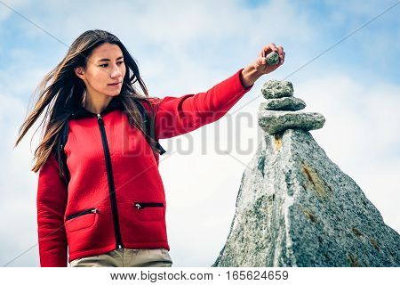 Young Woman at the Top of the Mountain. Shot taken in Swiss Alps, near Rhone Glacier and Furka Pass.
