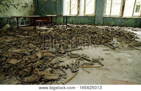 Infected Radiation Gas Masks On The Floor In An Abandoned Middle School In Chernobyl Nuclear Power P