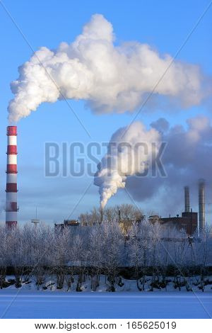 Smoke factory chimneys in the early morning