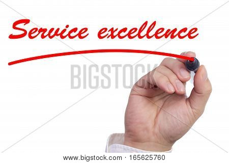 Hand underlining the words service excellence in red isolated on white