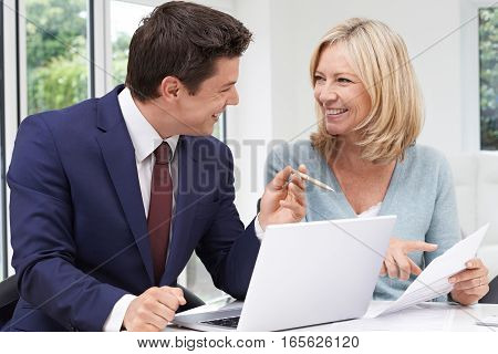 Mature Woman Meeting With Financial Advisor At Home