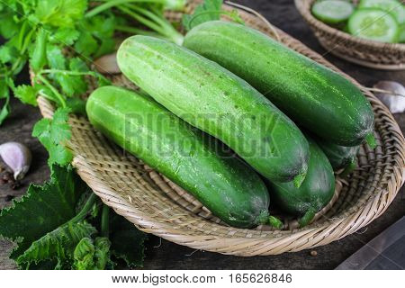 fresh cucumber on wooden background, raw organic vegetable
