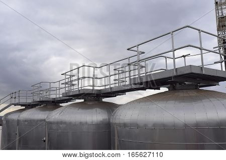 Fermentation Tank At A Brewery With Walkway And Platform