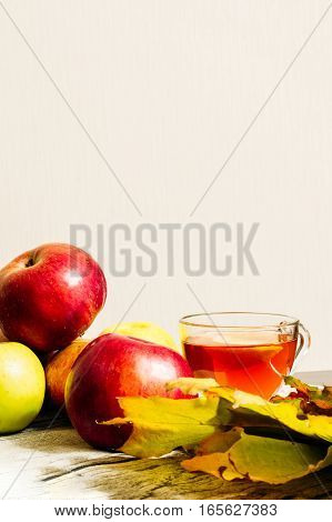 Apples Next To The Cup Of Tea
