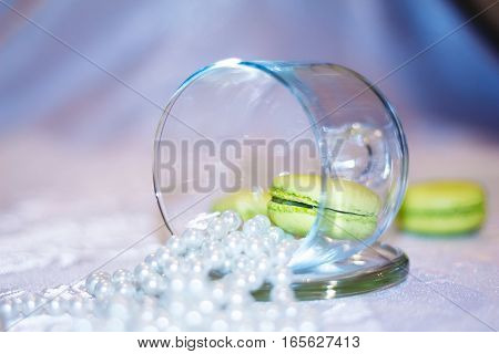 Macarons In A Glass Jar With Beads Of Pearls