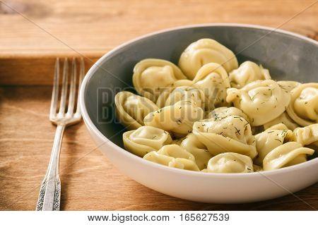 Dumplings stuffed with meat - pelmeni (russian food).
