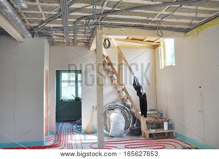 Close up on water floor heating system interior walls insulation and soundproofing. Interior Room Construction.