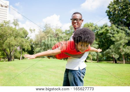 African American Family Having Fun In The Outdoor Park During Summer