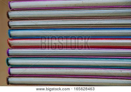 Stack Of Closed book a wooden table