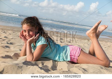 Pretty Girl And Lying On The Sand During The Summer Holidays