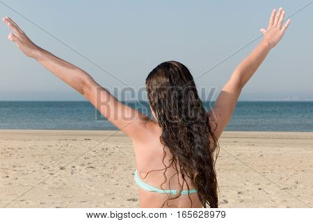 Very Happy Woman Is On The Beach Spreads The Arms Of Happiness