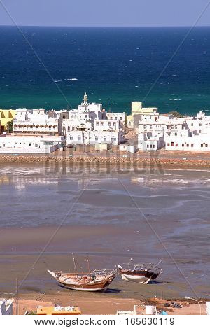 SUR, OMAN: Dhows (traditional sailing and fishing boats) at the Old Harbor in Ayjah