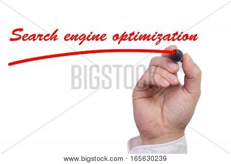Hand writing the words search engine optimization and underlining it in red isolated on white